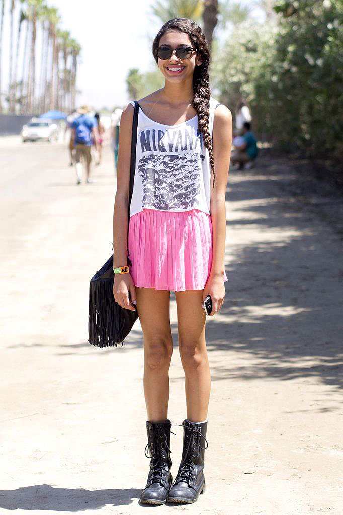 A girlie rocker look made up of a Nirvana tee, hot-pink skirt, and tough moto boots.
