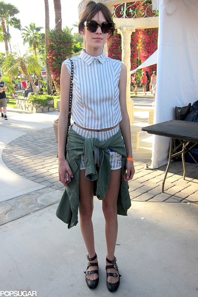 Alexa Chung showed off her stripes in a collared top, matching shorts, army shirt, and strappy flats on the fairgrounds.