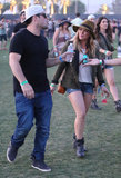 Hilary Duff layered up in a military-style jacket, a Rag & Bone fedora, denim cutoffs, and black boots.