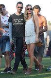 Kate Bosworth walked the Coachella grounds in a white leather scalloped tank and matching shorts, then added Ray-Ban aviators, a Jennifer Fisher cuff, and a tan bag and shoes.