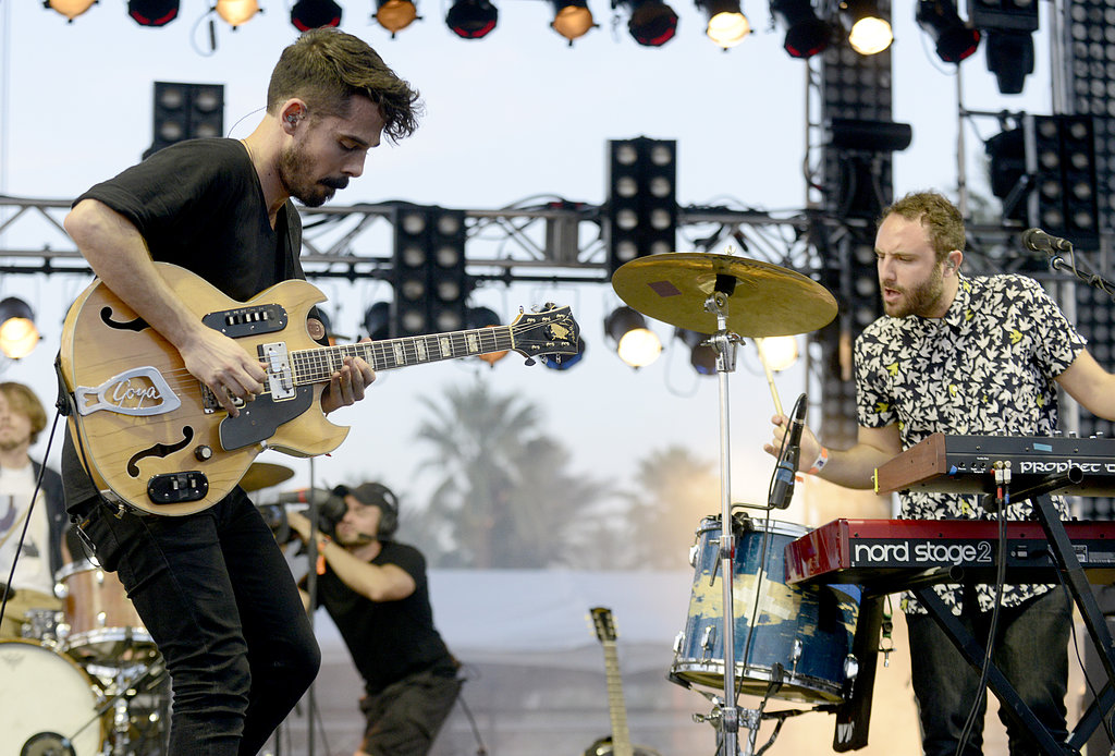 Local Natives members Taylor Rice and Kelcey Ayer got in the groove on stage.