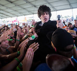 Singer Ian Svenonius from The Make-Up took his performance to the crowds.