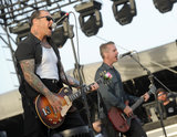 Mike Ness and Jonny Wickersham of Social Distortion gave crowds a lively show on Sunday.