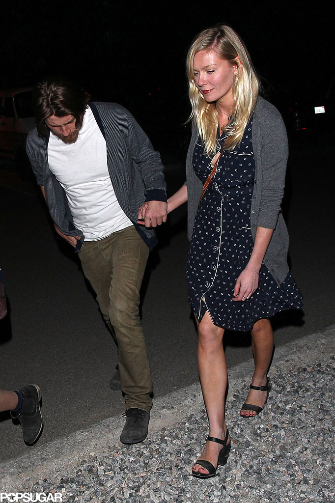 Kirsten Dunst and Garrett Hedlund held hands on their way into the Neon Carnival.