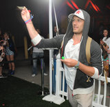 Alex Pettyfer tried his hand at darts at Armani Exchange's Neon Carnival.  Photo courtesy of Seth Browarnik/WorldRedEye.com