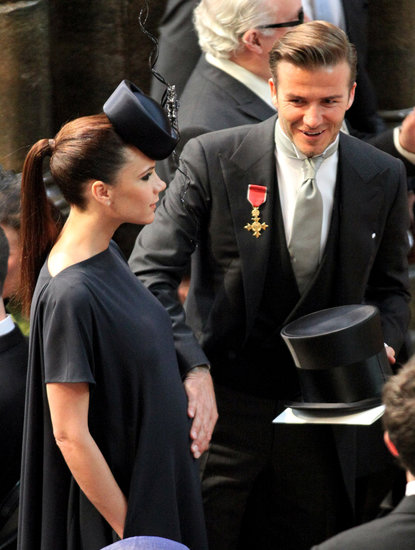 David Beckham put a hand on Victoria's pregnant belly at the royal wedding of Prince William and Kate Middleton in April 2011.