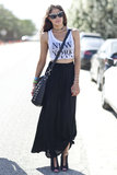 This Coachella party attendee showed off her city cred in black maxi, NYC tank, and tough accessories.