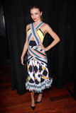 Miranda Kerr turned it out in this calf-length, cutout Peter Pilotto dress and pointy-toe pumps at a pre-Oscars party in February.