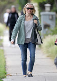 Naomi Watts kept her army green jacket laid-back with a pair of cropped skinny jeans, a gray tee, black loafers, and a black-and-white tote bag.