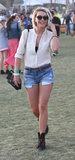 Julianne Hough styled a pair of cutoffs with a button-down and boots for a festival-cool look.