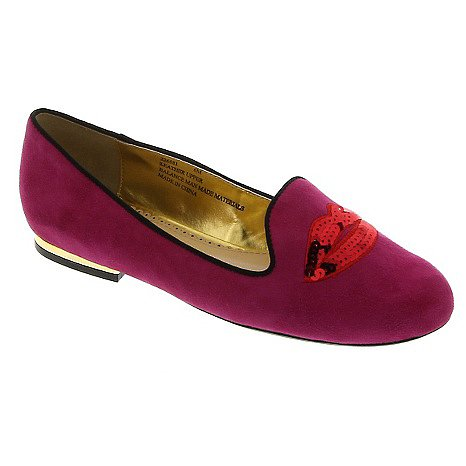 Iris Apfel Suede Smoking Lip Loafer From these lips to everyone else's, you can bet people will be talking about this classic shoe with a pop-art twist. Try it on a cool Spring day with tights and skirts or dockside with trousers and a lightweight slouchy sweater.