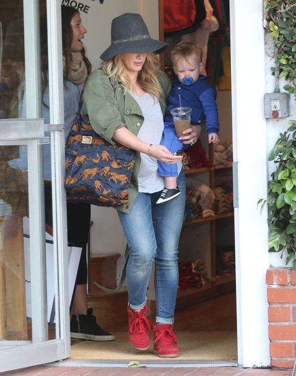 Hilary Duff's Current/Elliott army jacket played beautifully with her red Isabel Marant sneakers during a day out with her son Luca in West Hollywood.
