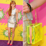 Bella Thorne clutched this Juicy Couture neon yellow Lucite minaudière  ($148) with her metallic Bec & Bridge ensemble, Alice + Olivia pumps, and Dannijo jewelry at Nickelodeon's 26th Annual Kids' Choice Awards in LA.