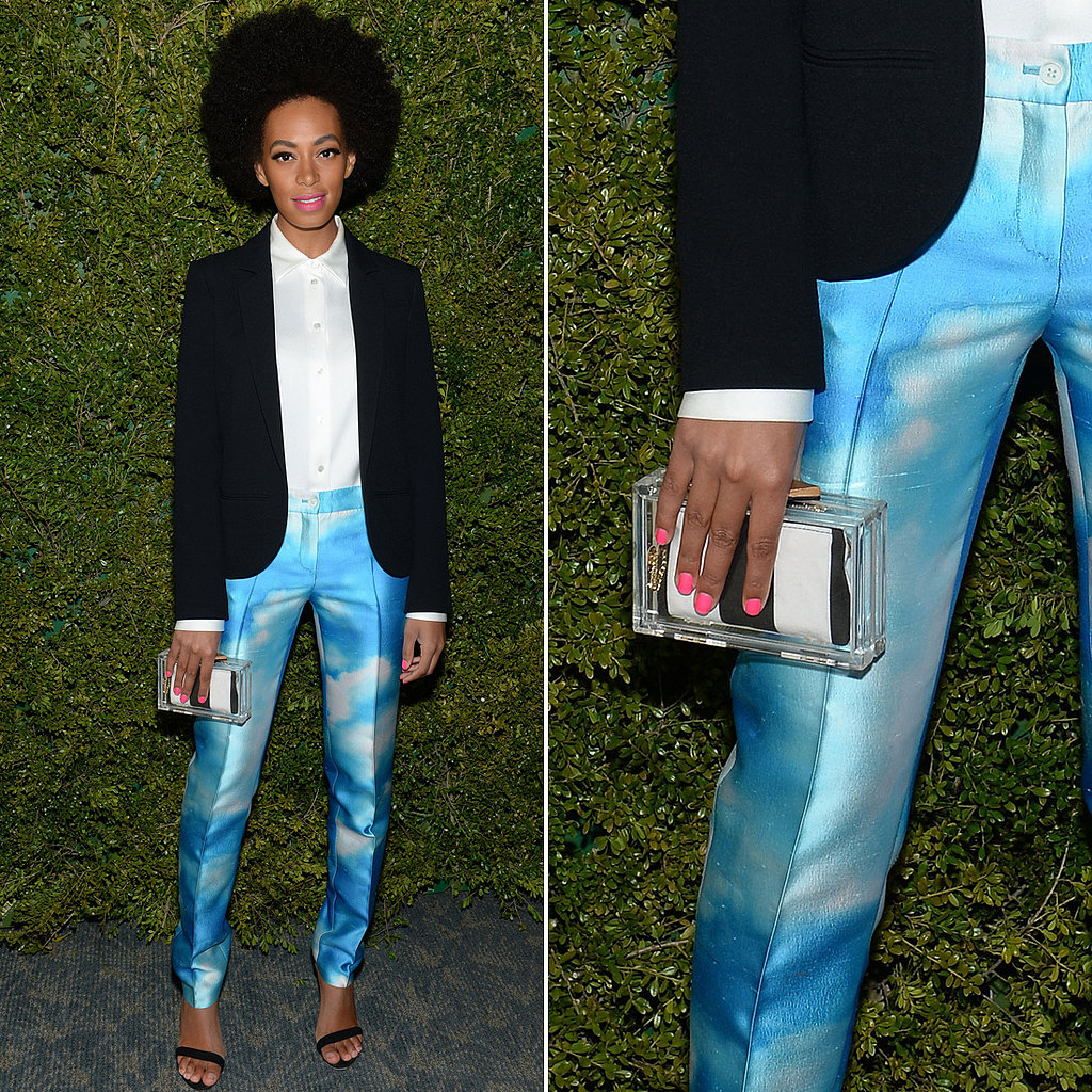 Solange Knowles accented her cloud-print pants with Alice + Olivia's striped Lucite clutch at a Michael Kors event in LA.