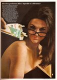 "We see the bespectacled brunette version of the sexy librarian in this vintage Tiparillo cigar advertisement from 1967 that asks, ""Should a gentleman offer a Tiparillo to a librarian?"""