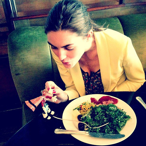 Hilary Rhoda may not have been playing with her food, but she was playing with her Dannijo earrings at the table. Source: Instagram user hilaryhrhoda