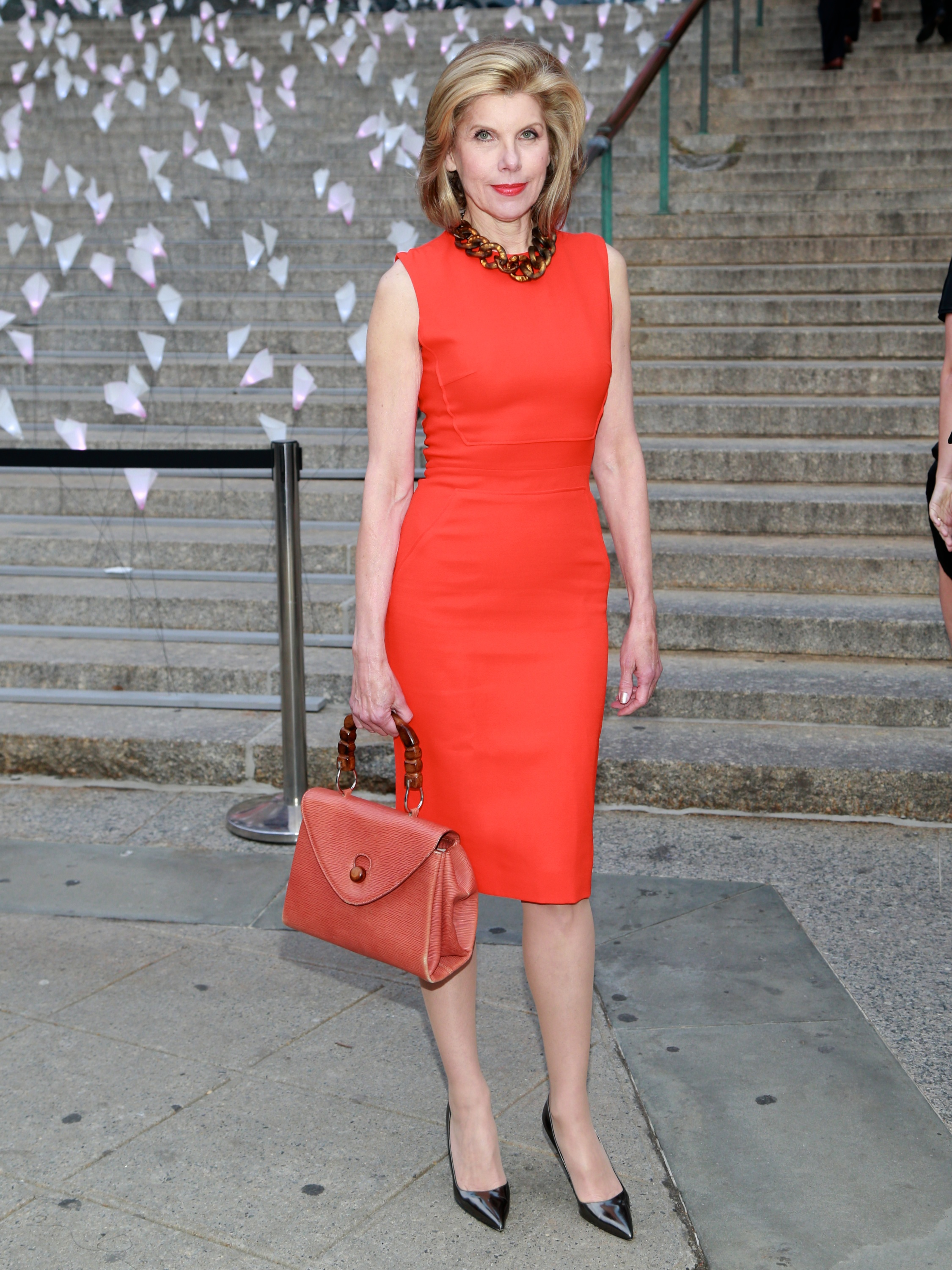 At Vanity Fair's Tribeca Film Festival party, Christine Baranski wore a red dress and held a matching red bag.