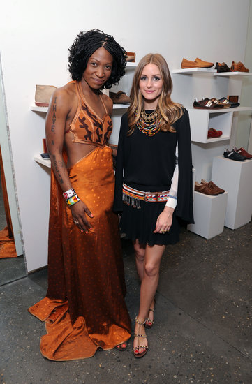 Olivia styled a black skirt and top with eclectic, global-feeling accessories, like layers of colored necklaces, an embroidered belt and a pair of beaded sandals for an appearance at the Pikolinos pop up store opening celebrating the Maasai Project.