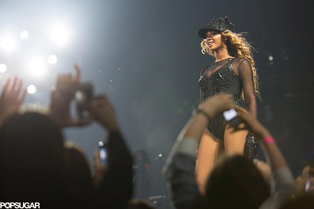 Beyoncé showed off a sportier look: a black embellished leotard with sheer sleeves and a matching baseball cap.
