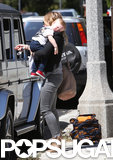 Luca Comrie rested on his mom Hilary Duff's shoulder.