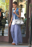 While grabbing lunch with her family in LA's Studio City neighborhood, Jessica donned a Genetic Denim vest, a blue printed maxi skirt, and a silver mirrored Dolce & Gabbana bag.