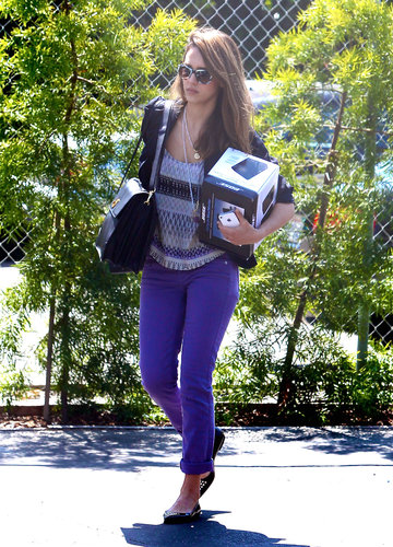 While some may think purple is reserved for children, the actress made a stylish case for the vivid hue, working purple skinny jeans, an Aztec-print tank, and a sleek leather bag and tie-dye shades, both by Tory Burch, on her way to her Santa Monica office.