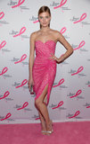 Constance Jablonski showed her support at The Breast Cancer Research Foundation's Hot Pink Party in a hot pink draped, strapless cocktail dress and metallic heels.