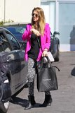 On her way to her office in Santa Monica, Jessica mixed trends in a hot pink blazer, star-print denim, textured Rebecca Minkoff boots, and her trusty Michael Kors crossbody.
