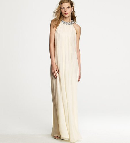 We love the romantic, billowy silhouette of this gorgeous J.Crew Amelia gown ($1,800). Plus, the embellished neckline adds an elegant detail for interest.