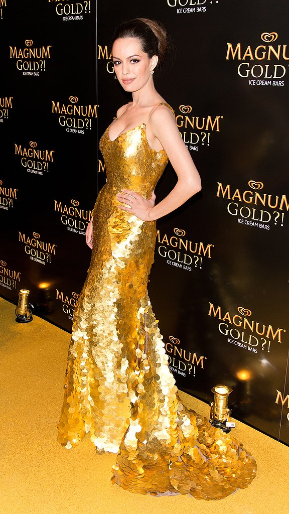 Brazilian model/actress Caroline Correa wore the $1.5 million, 24-karat gold dress designed by Zac Posen for the As Good as Gold premiere at the Magnum Ice Cream event.