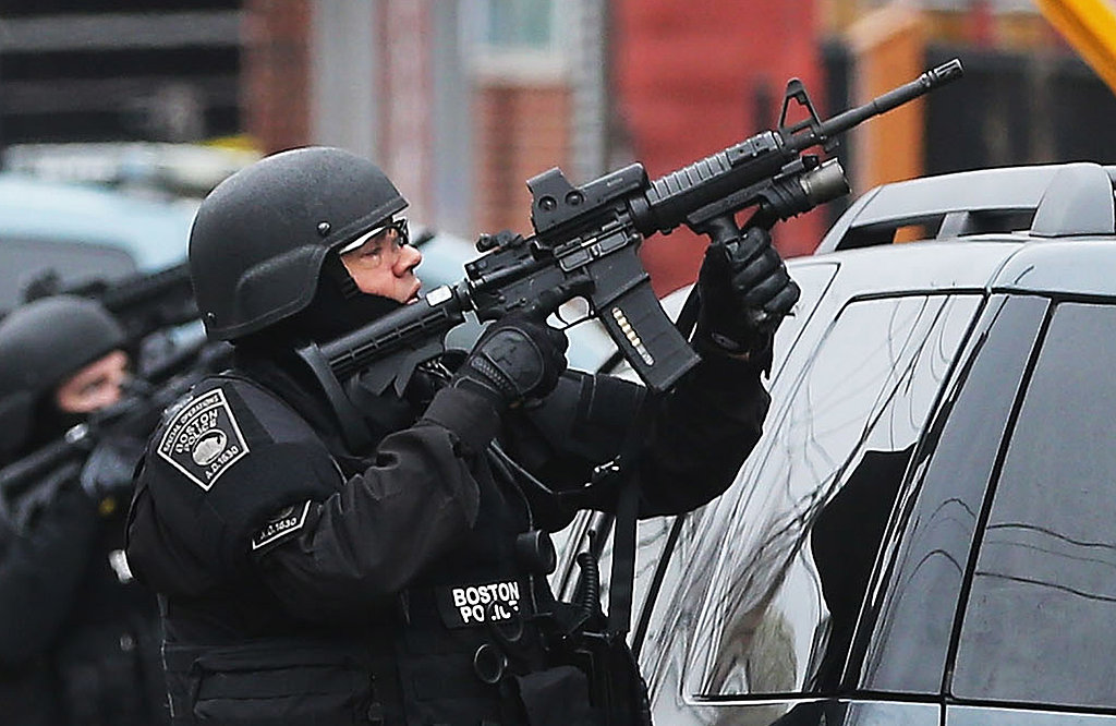 SWAT team members took position during their hunt for the suspect in Watertown.