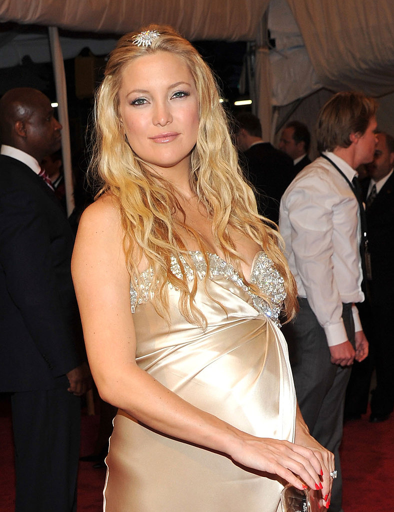 A very pregnant Kate attended the Alexander McQueen: Savage Beauty Met Gala in 2011. She topped off her cascading waves with a regal hair accessory.