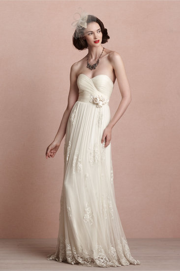 The fitted bodice on this Catherine Deane gown ($1,800) provides a romantic finish to this soft and airy lace creation.