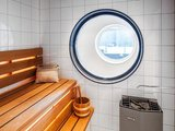 Double round mirrors in the sauna channel a nautical style. Source: Sotheby's