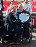 Prince Harry held a trophy with Tatyana McFadden, winner of the women's wheelchair race.