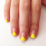Take the edge of your favorite neon polish up a few notches with this easy-to-DIY V-shaped manicure idea.