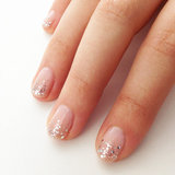 Try this minimalist approach to sparkling nail art for a fancy night out.