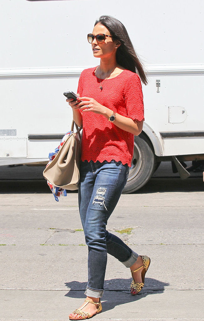 While out and about in Beverly Hills, Jordana Brewster showed how to make your casual denim more springy: via a punchy scalloped top, metallic sandals, and a nude bag.