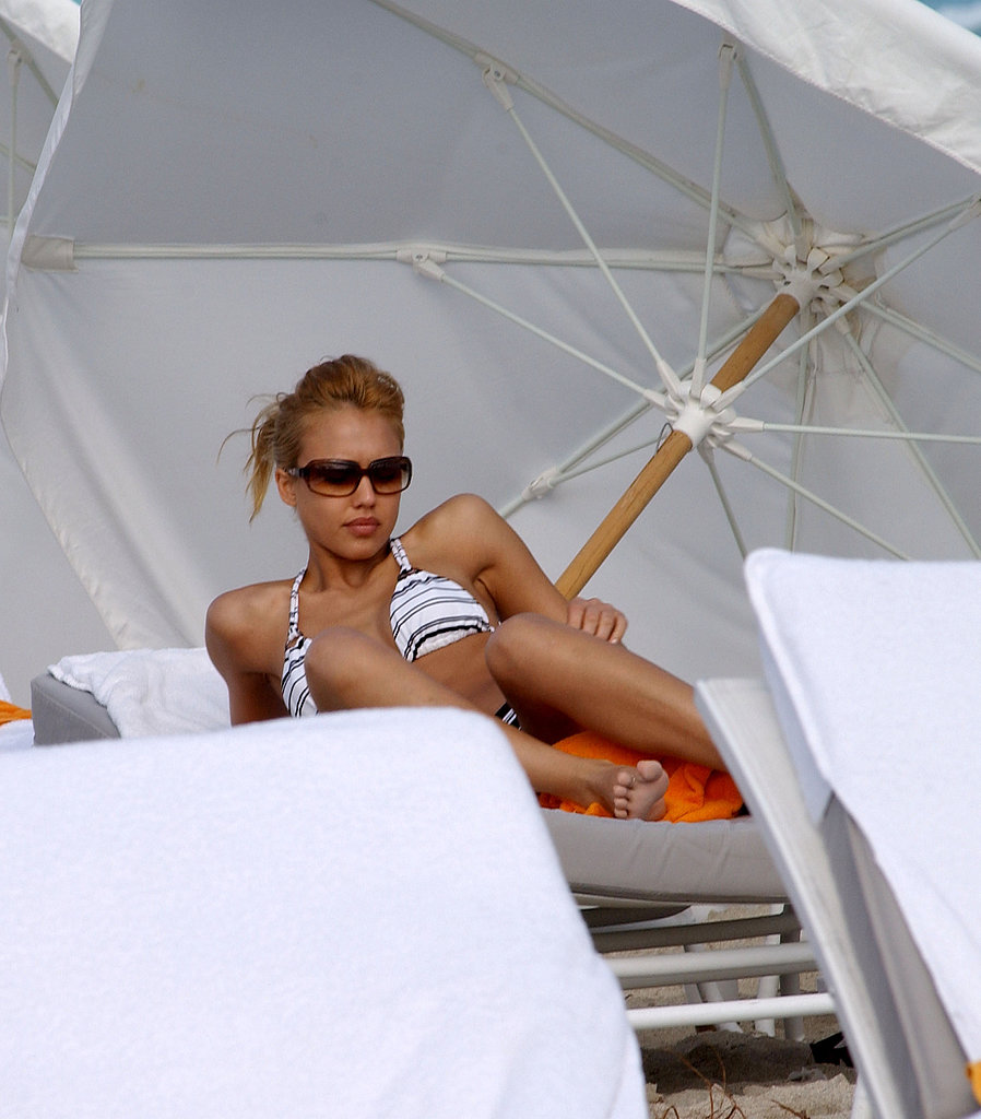 Jessica Alba relaxed in shades and a striped bikini in South Beach in January 2005.