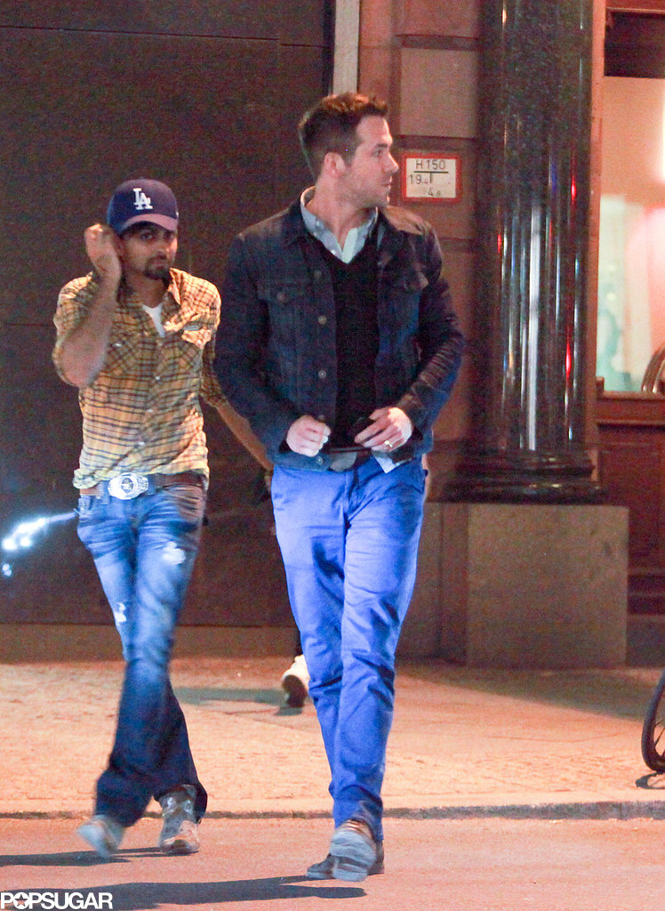 Ryan Reynolds walked across the street with a friend.