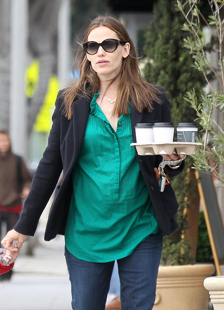 Jennifer Garner carried a tray of drinks in LA on Monday.