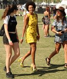 Solange Knowles wore a bright yellow dress and heels around Coachella.