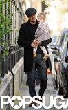 David Beckham carried Harper through Notting Hill in London.