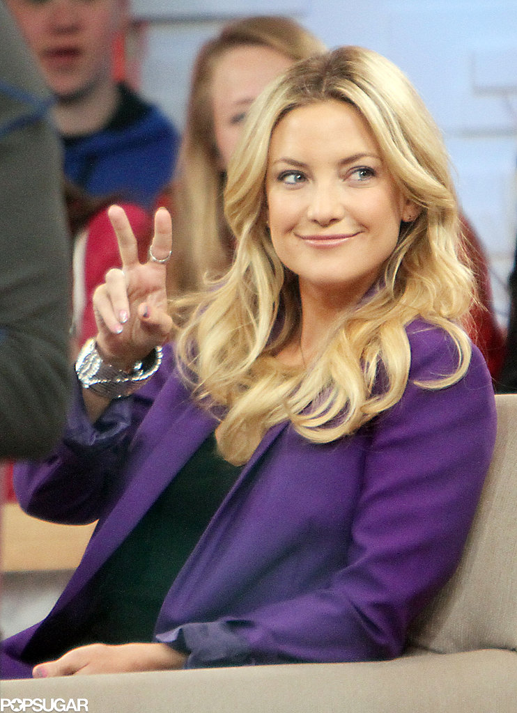 Kate Hudson flashed a peace sign.