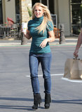 Britney Spears wore tight blue jeans and a green turtleneck while grabbing coffee.