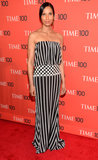 Padma Lakshmi hit the red carpet at the Time 100 Gala in a strapless black-and-white striped gown. Since the gown was covered in such a distinct graphic detail, Lakshmi did little else in the way of accessorizing, only adding a pair of delicate green drop-tassel earrings to the mix.
