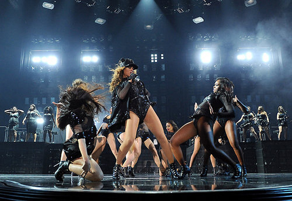 Beyoncé busted a move in her studded Givenchy cape getup.