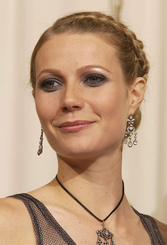 At the 2002 Oscars, Gwyneth Paltrow went slightly goth with a purple-tinged smoky eye and a plaited bun hairstyle.