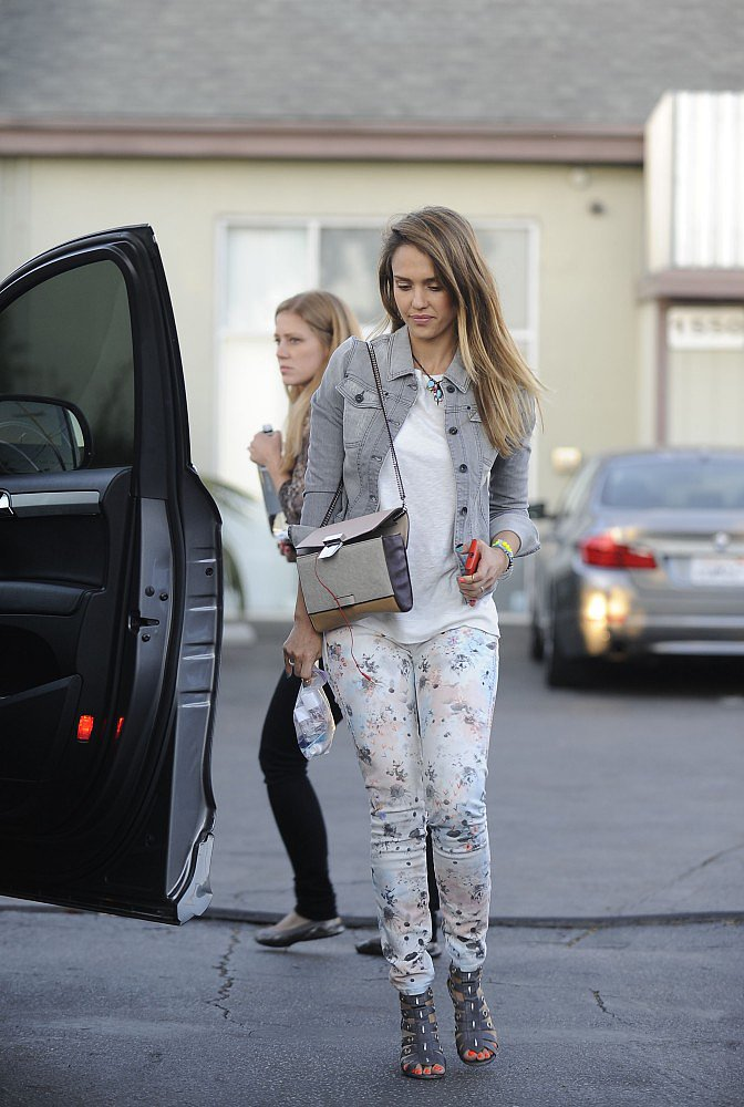 Jessica Alba perfected denim on denim, adding a faded jean jacket to floral bottoms while out in LA.