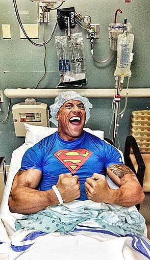 Dwayne Johnson showed off his Superman status after having hernia surgery. Source: Twitter user TheRock
